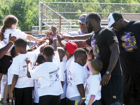 Malcolm Jenkins (right center) with kids from his annual