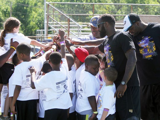 Malcolm Jenkins (right center) with kids from his annual summer camp in Piscataway
