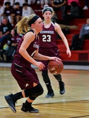 Brownwood's Sage Cupps drives into the Sweetwater defense