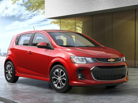 A red 2018 Chevrolet Sonic, a subcompact hatchback.