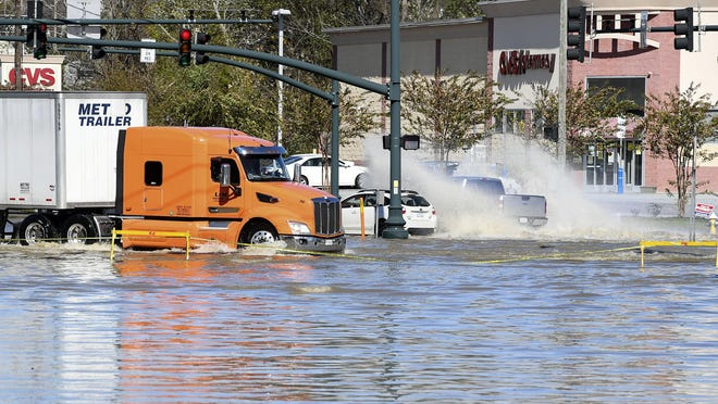 The corner of White Street and Greenville Highway was flooded from Tropical Storm Zeta Thursday.