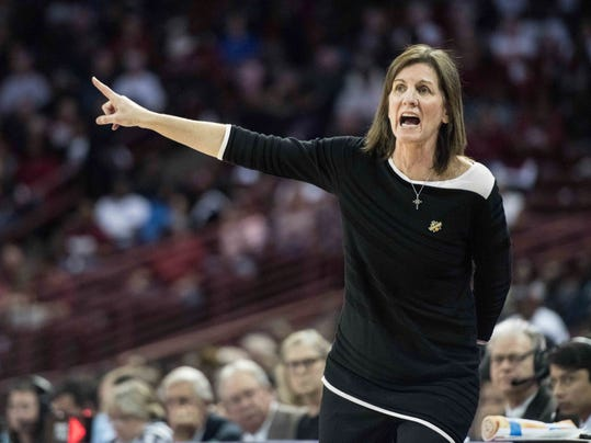 Virginia head coach Joanne Boyle communicates with players during the first half of a second-round game of the NCAA women's college basketball tournament, Sunday, March 18, 2018, in Columbia, S.C. South Carolina defeated Virginia 66-56. (AP Photo/Sean Rayford)