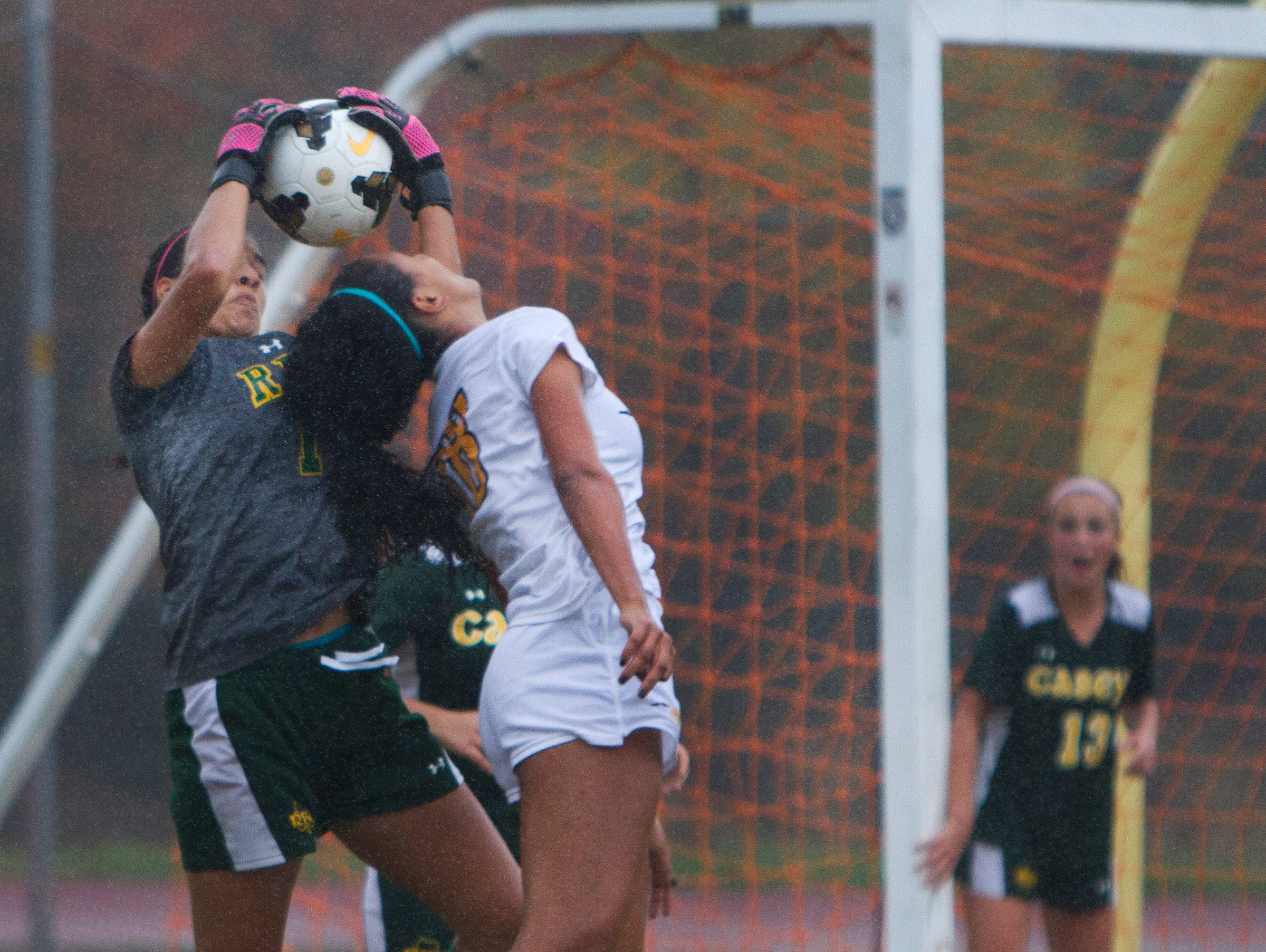 Red Bank Catholic goalie Jackie Robinson pulls ball away from St. John Vianney's Sydney Cummings as Red Bank tries to maintain its 1-0 lead during closing minutes. Red Bank Catholic vs St. John Vianney in NJSIAA State Soccer tournament