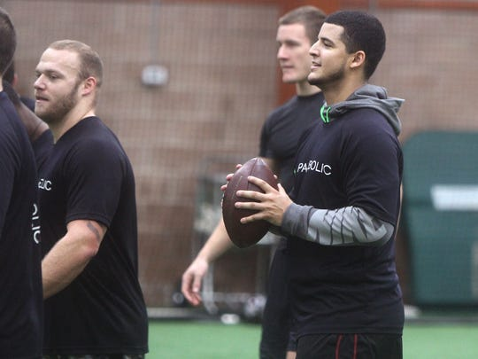 Quarterback Gary Nova (front, fight) and fullback Sam Bergen (left) are two of those providing a Rutgers flavor to NFL Draft training in Farmingdale.