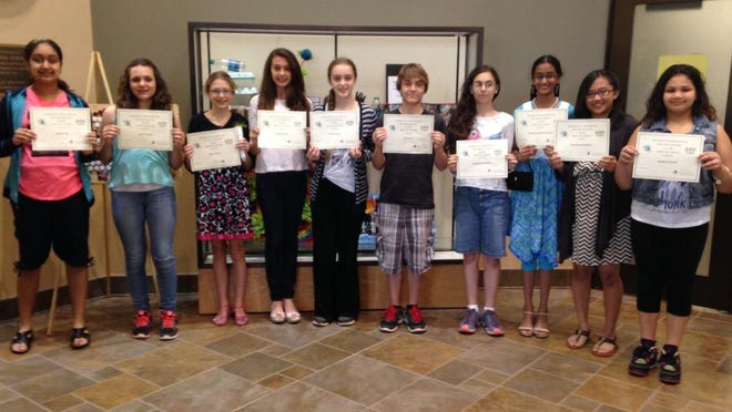 "Several students from Bridgewater-Raritan Middle School received awards for their participation in the ""Smart Art"" contest, sponsored by the Bridgewater Township Environmental Commission and Creative Arts Committee. Some of the participants were, from left: Sneha Yalgi, Lauren Renna, Ester Freider, Rachel Pinho, Emily Murray, Will Busler, Elizabeth Gershater, Subha Pranathi Nanduri, Marecella Macalalaly, and Heather Novick."