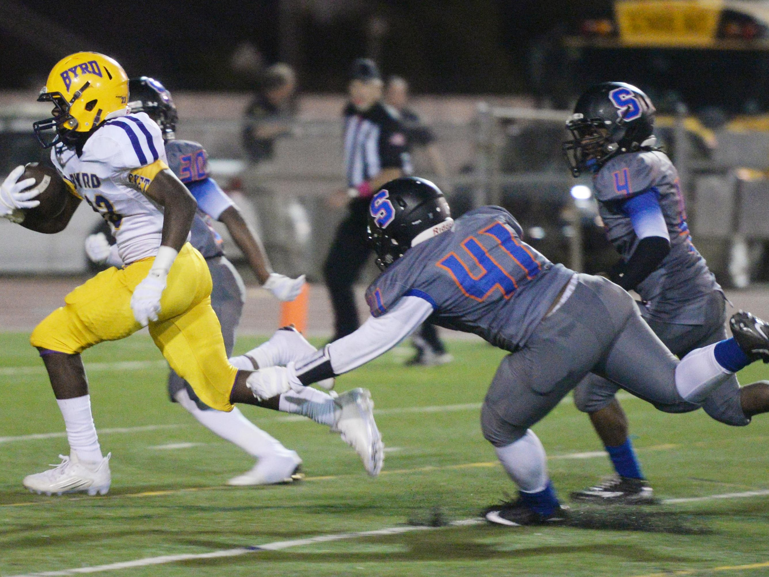Byrd's Javier James (23) runs past Southwood's defense for a touchdown during Friday's District 1-5A game at Lee Hedges Stadium.
