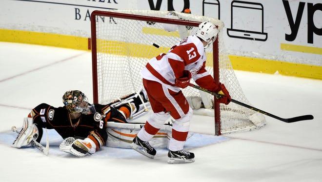 Detroit Red Wings center Pavel Datsyuk (13) misses the net against Anaheim Ducks goalie John Gibson (36) in the overtime shootout period during the game at Honda Center.