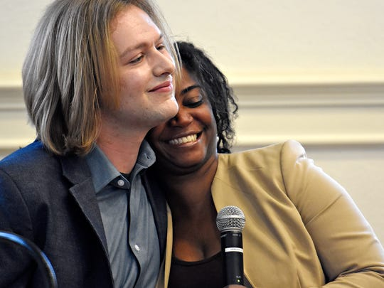 Moderator Shane Coolbaugh, left, of the York County Young Democrats shares a hug with York County's NAACP chapter president Sandra Thompson, following her remarks regarding recent events of alleged discrimination at a local golf course, prior to the democratic debates for three contested Democratic primary races at Marketview Arts in York City, Thursday, April 26, 2018. Dawn J. Sagert photo