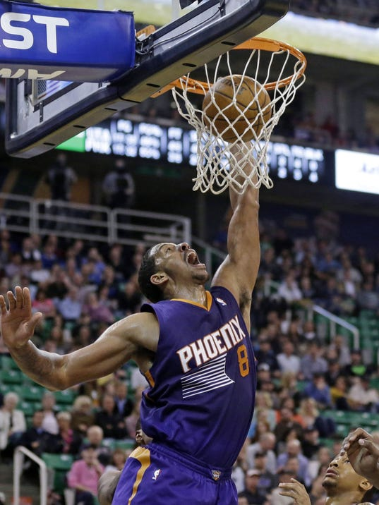 FILE - In this Feb. 26, 2014, file photo, Phoenix Suns' Channing Frye dunks the ball in the second quarter of an NBA basketball game against the Utah Jazz in Salt Lake City. A person familiar with the deal says veteran forward Frye has agreed to a four-year, $32 million deal with the Orlando Magic. The person spoke Monday, July 7, 2014, on condition of anonymity because the deal can't be signed until July 10 under NBA free agency rules. (AP Photo/Rick Bowmer, File)