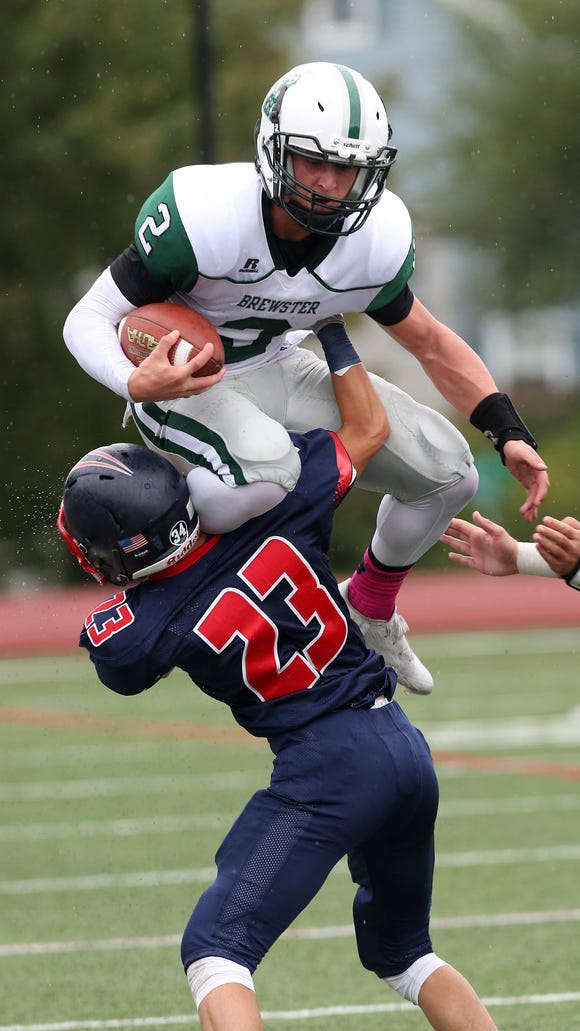 Brewster's Jack Guida (2) tries to jump over Eastchester's Nick Genova (23)  on a first half run during football action at Eastchester High School Oct. 8, 2016. Guida received a penalty on the play and Brewster went on to defeat Eastchester 42-24.