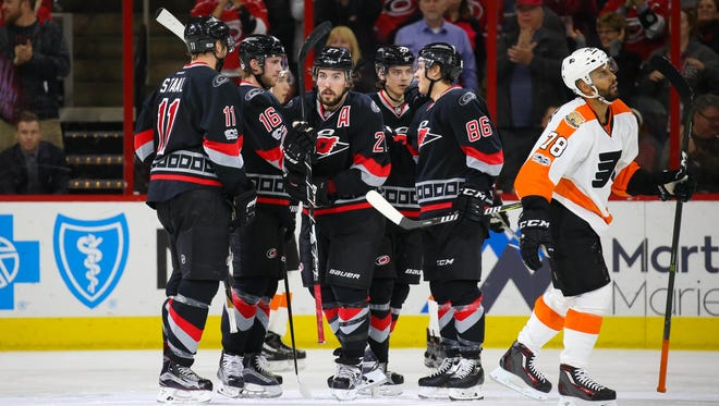 Justin Faulk, center, had one of five goals against the Flyers. Sebastian Aho had three.