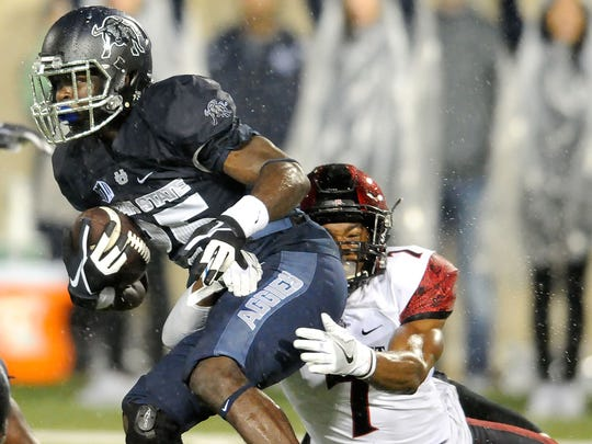 Utah State wide receiver Gerold Bright (25) gets tackled