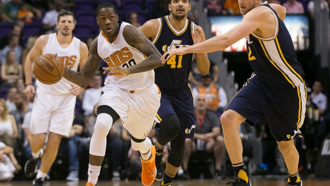 Suns' Archie Goodwin (20) drives around Jazz's Joe Ingles (2) in the first half at Talking Stick Resort Arena in Phoenix, Ariz. on Sunday, April 3, 2016.