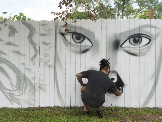 Louichyz Labastida, of Port St Lucie, spray paints