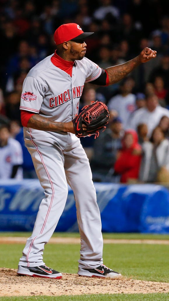 Reds relief pitcher Aroldis Chapman reacts at the end of Tuesday's baseball game against the Chicago Cubs at Wrigley Field.