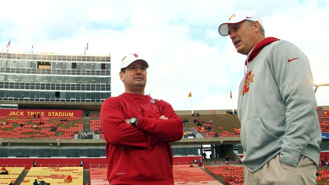 Bob Stoops and Paul Rhoads discuss things before a 2012 matchup at Jack Trice Stadium.
