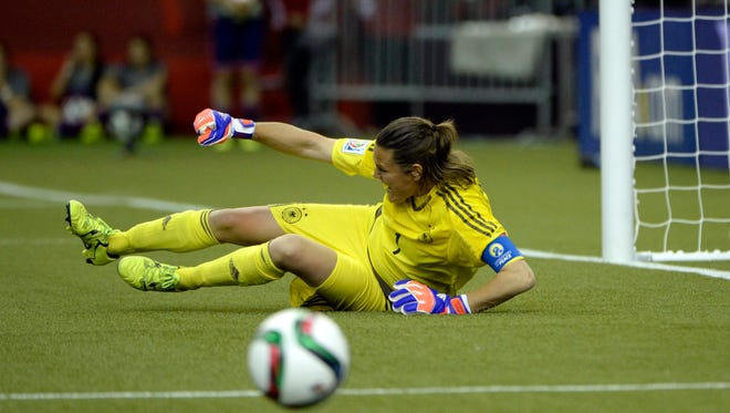 Germany goalkeeper Nadine Angerer (1) reacts after making a save on the final penalty kick to defeat France during in penalty kicks during the quarterfinals of the FIFA 2015 Women's World Cup.