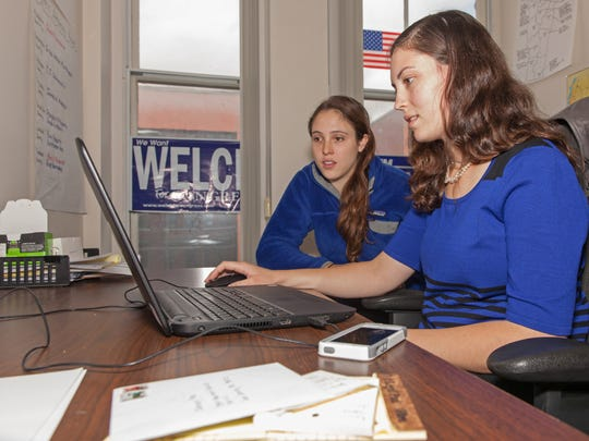 Liz Kane, right, and Sarah Simmons work as field organizers for the Democratic Party in Vermont.