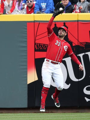 Cincinnati Reds right fielder Jesse Winker (33) makes a catch in the third inning during the National League baseball game between the Chicago Cubs and the Cincinnati Reds, Monday, April 2, 2018, at Great American Ball Park in Cincinnati.