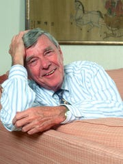 Author Russell Baker poses for a portrait in 2003,