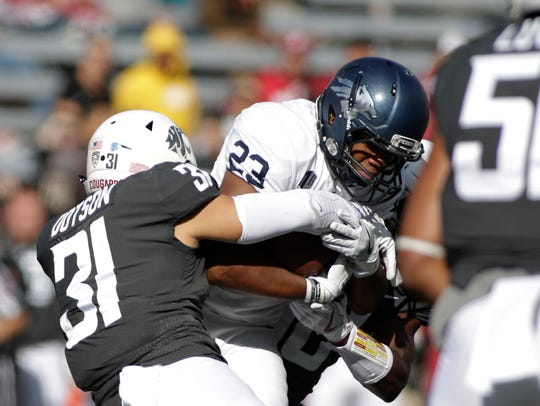 Washington State linebacker Isaac Dotson tackles Nevada