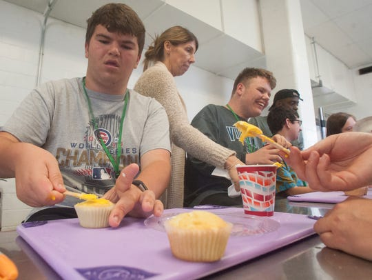 SMASH program student Mac Banquier makes cupcakes at the Moorestown Recreation Center.