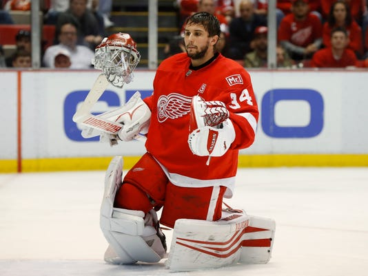 Detroit Red Wings goalie Petr Mrazek (34) flips his helmet off his stick after it came off during play against the Montreal Canadiens in the third period of an NHL hockey game Saturday, April 8, 2017, in Detroit. (AP Photo/Paul Sancya)