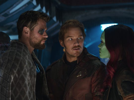 """Thor (Chris Hemsworth), from left, Star-Lord/Peter Quill (Chris Pratt) and Gamora (Zoe Saldana), with Drax (Dave Bautista) in the background in a scene from Marvel Studios' """"Avengers: Infinity War."""""""