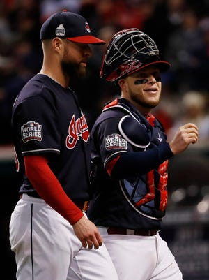 Corey Kluber (L) provided the pitching and Roberto Perez (R) provided the power in Game 1.
