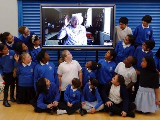 Patriotic songstress Vera Lynn Skypes with pupils from