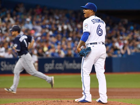 Toronto Blue Jays starting pitcher Marcus Stroman stands on the mound as San Diego Padres' Alex Dickerson rounds the bases after hitting a three-run home run during the sixth inning of a baseball game Tuesday, July 26, 2016, in Toronto. (Frank Gunn/The Canadian Press via AP)