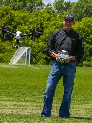 Chris Knight, CEO of SparkNET and a member of the Green Bay Area Drone User Group, flies his drone at Southwest Park in De Pere.