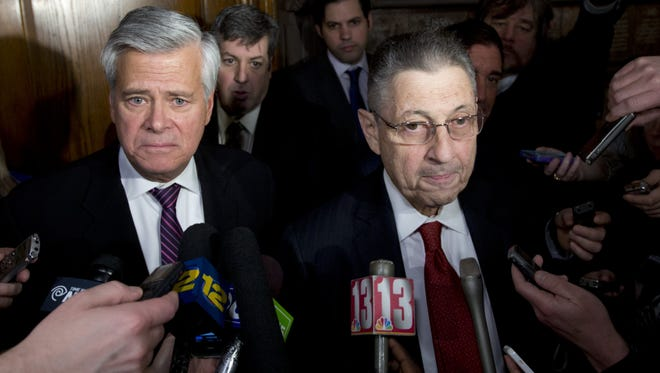 Then-Senate Republican leader Dean Skelos, R-Rockville Centre, left, and then-Assembly Speaker Sheldon Silver, D-Manhattan, talk to reporters outside Gov. Andrew Cuomo's office at the Capitol after a budget meeting in 2014.