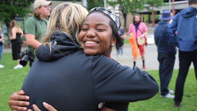 Mikaela McNeil, 16, of Pleasant Valley, hugs a friend on Sunday. She was one of the students calling for action in the wake of school shootings.