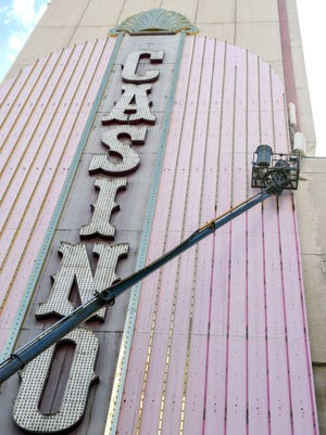 Sign and crane workers disassemble the Virginian Casino sign facade June 29, 2016. The Virginian was purchased by The Siegel Group and converted into apartments.