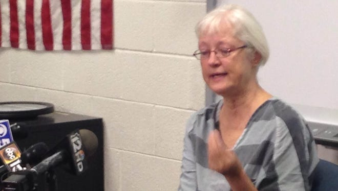 Marilyn Hartman begins to cry as she speaks to the media at Estrella Women's Jail in Phoenix