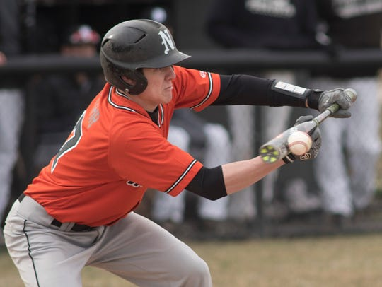 Taking a cut during Monday's game against Plymouth is Northville's Billy Flohr (17), who was a thorn in the Wildcats's side. Northville won 6-3.