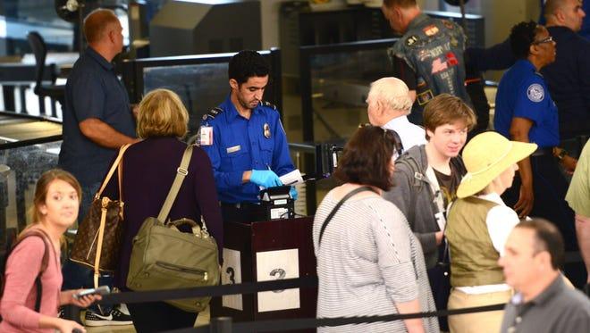 Passengers go through the TSA checkpoint in Terminal C at Newark Liberty Airport.