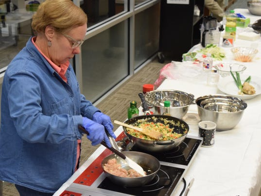 """Frances Boudreaux, director of the Good Food Project, prepares Cauliflower """"Fried Rice"""" for the Rapides Parish Library's program on preparing healthy meals. The program is held on the first Monday of every month."""