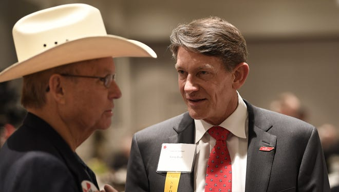 Brian Roquemore listens to gubernatorial candidate Randy Boyd at the Williamson County Republican Party's annual Reagan Day Dinner on Feb. 23, 2018, in Franklin.