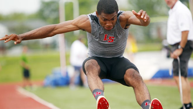 La Salle's Tim Bell jumped 23 feet, 11 3/4 inches in the the second of three preliminary flights at Winton Woods High School on Wednesday. His jump was second in the state to the 24-3 1/4 of Fairfield's Herman Brunis in the same meet.
