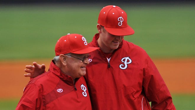 Petal head baseball coach Larry Watkins hugs his son and Petal pitching coach, Tyler Watkins, as Larry is honored for his 800th career win.