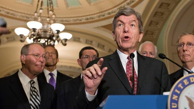 Sen. Roy Blunt, R-Mo., center, and Sen. Lamar Alexander, R-Tenn., far left, announced their opposition to the Syria resolution.
