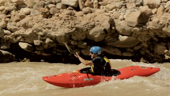 Navy veteran Lonnie Bedwell kayaks through the Grand Canyon.