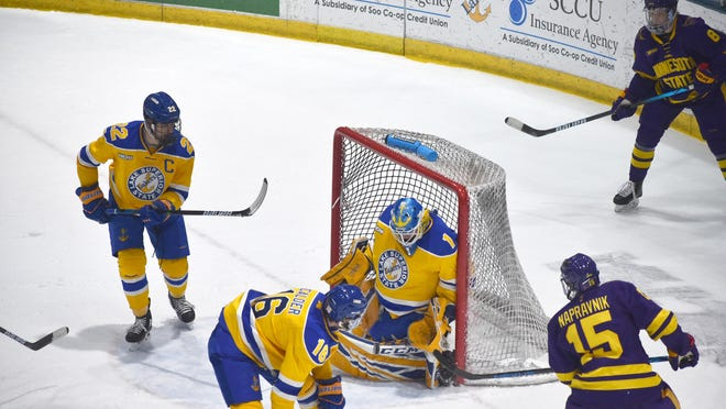 Lake Superior State netminder Ethan Langenegger controls a rebound in the second period against Minnesota State Saturday night at Taffy Abel Arena. The Laker freshman had 25 saves in relief of Mareks Mitens.