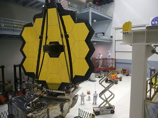 Engineers and technicians assemble the James Webb Space Telescope on Nov. 2, 2016 at NASA's Goddard Space Flight Center in Greenbelt, Md. Its launch has been delayed until 2021 at the earliest.