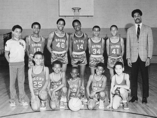 Gil Jackson (far right) and one of his Brown Boys' Club basketball teams.