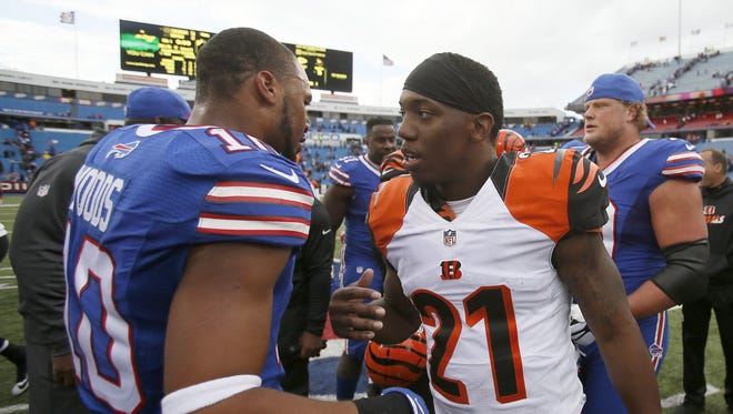 Bengals cornerback Darqueze Dennard (right) came up with his first career interception in a win over Buffalo.