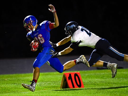 St. Cloud Apollo wide receiver Jonh Sithamat is pushed