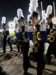Members of Cooper High School's band exit the field after their performance in the Big Country Marching Festival on Oct. 16 at Wylie High Shcool. Cooper earned a superior rating, which it hopes to duplicate at UIL region contest at the same site Monday.